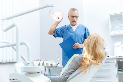 dentist speaking with patient during appointment