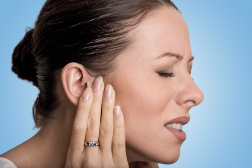 woman in pain with an ear ache