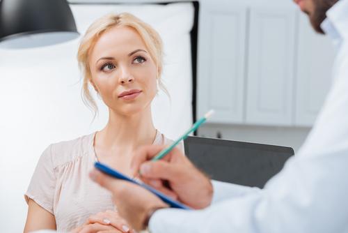 patient listening to dentist's consultation